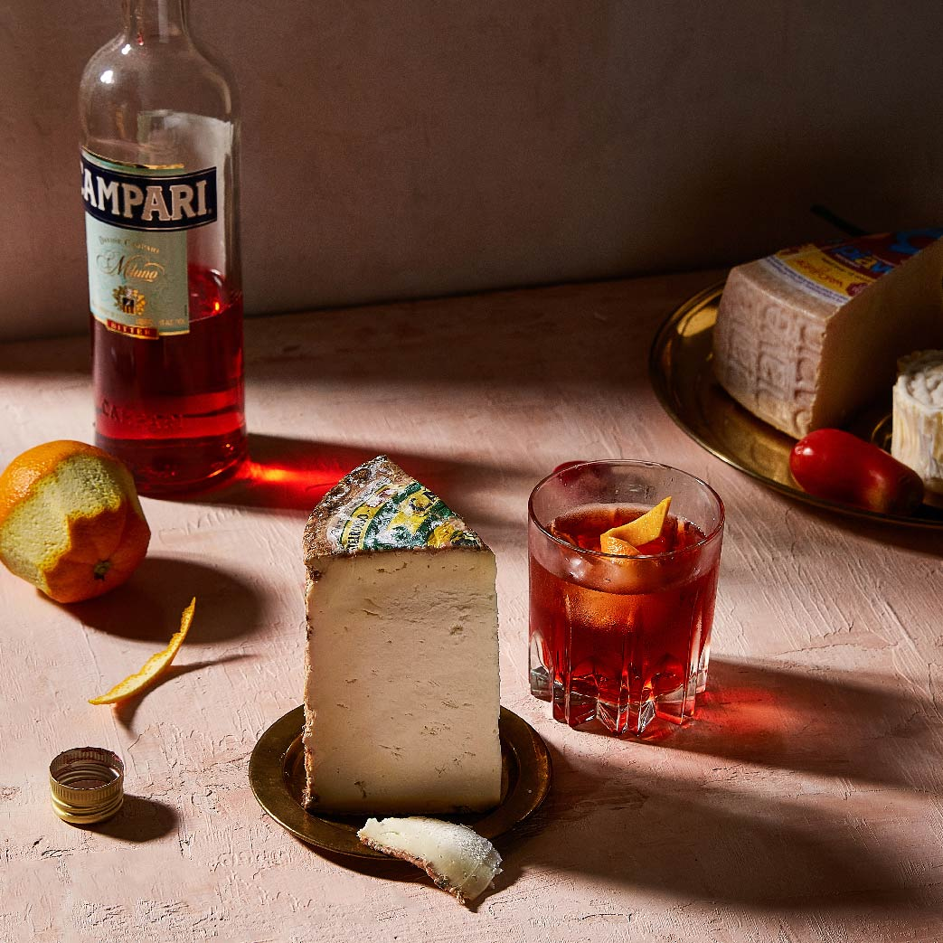 Negroni Coktail Paired With Castelrosso Cheese