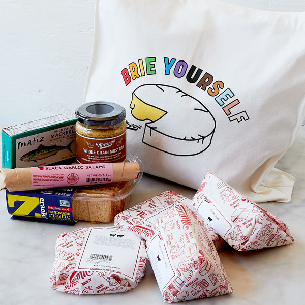 Tote Filled with Items and Showing Rainbow Wedge of Cheese Graphic
