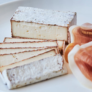 Slices of Murray's Cave Aged BBQ Camembert with Wedge and Slices of Prosciutto