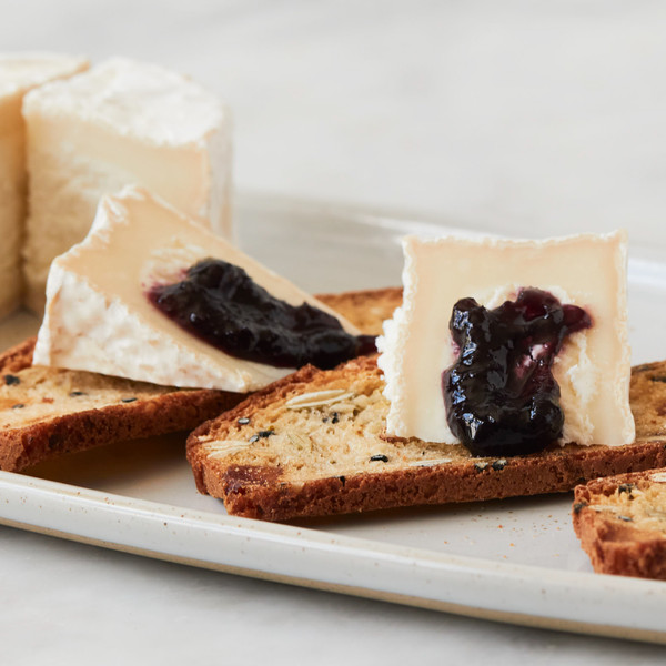 Wedges of Little Giant Topped with Jam on Crackers