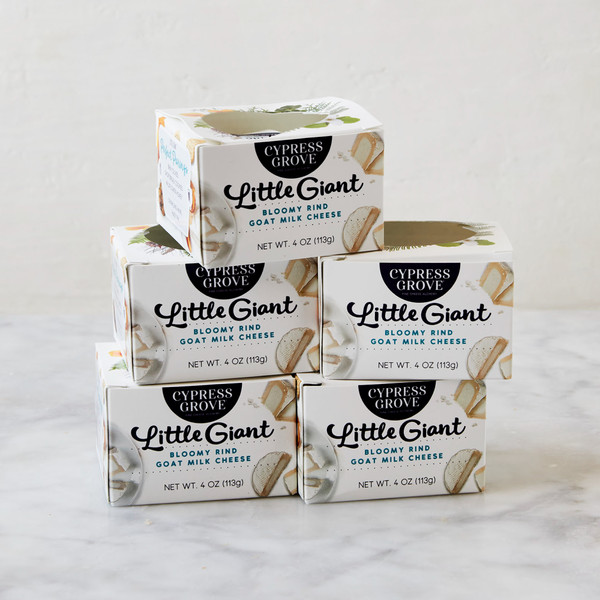 Five Packages of Little Giant Stacked on Each Other