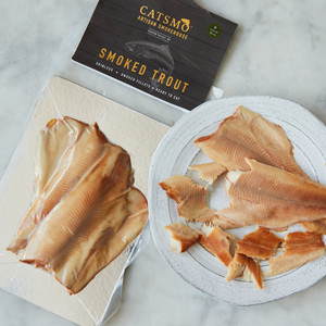 Package of Smoked Trout Next to Plate of Smoked Trout