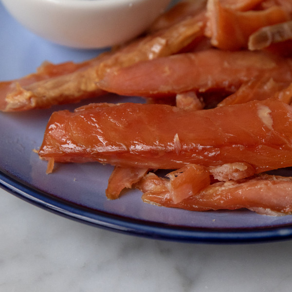 Close Up of Catsmo Candy Smoked Salmon Slices on a Plate