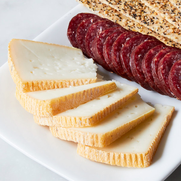 Slices of Dream Weaver on Plate with Salami Slices and Crackers