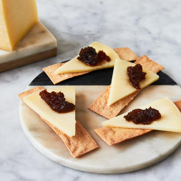 Slices of Campollano Topped with Jam and on Crackers