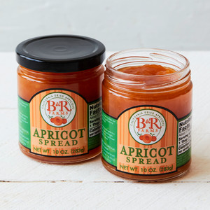 Open Jar of Dried Apricot Spread Next to Sealed Jar