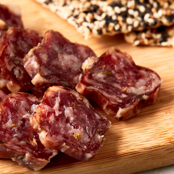 Slices of Vermont Salumi Fennel Salami on Platter Next to Crackers