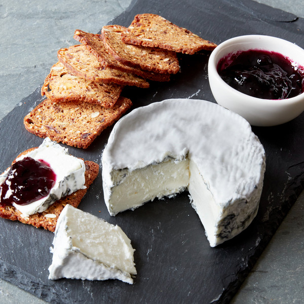 Wedge with Cut Wheel of Idyll Puck on Slate with Crisps and Jam