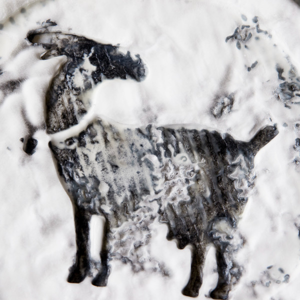 Close Up of Goat Imprint on Top of Idyll Puck Wheel