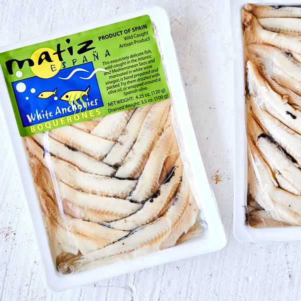 Sealed Package of Matiz Boquerones Next to an Open Package
