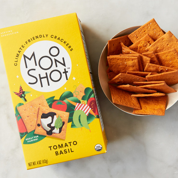 Box of Moonshot Tomato and Basil Crackers Next to Bowl of Loose Crackers