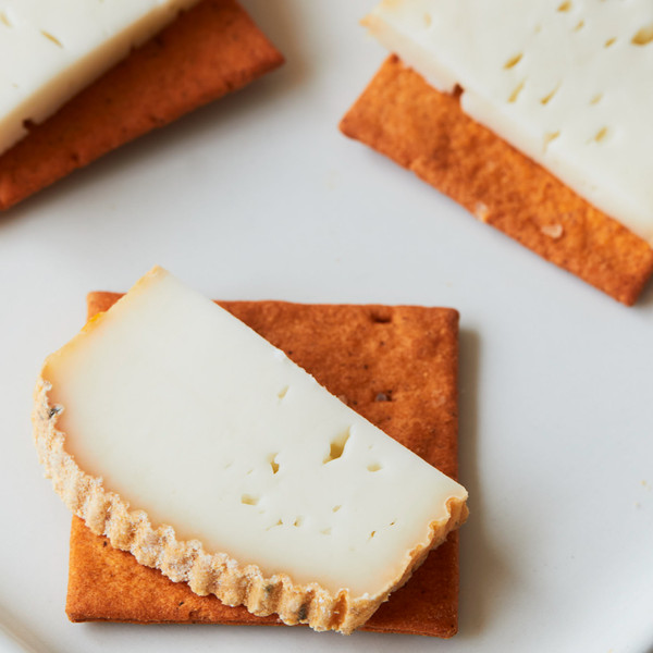 Three Moonshot Tomato and Basil Crackers Each Topped with Cheese