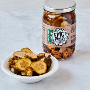 Sealed Jar of Epic Pickles Sweet and Spicy Next to Ramekin of Epic Pickles Sweet and Spicy