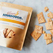 Loose Sourdough Cheese Crackers Next to Bag of Crackers