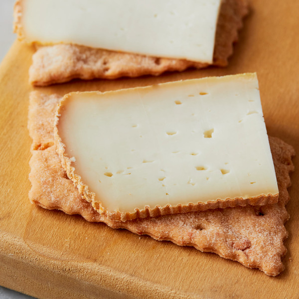 Sourdough Cheese Cracker Topped with Slice of Cheese