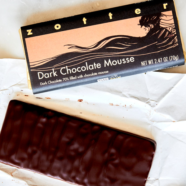 Unwrapped Bar of Dark Chocolate Mousse Next to a Wrapped Bar