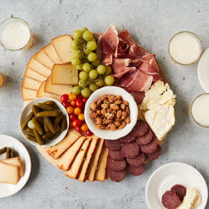 Father's Day Feast Divided on Three White Plates with Two Glasses of Red Wine