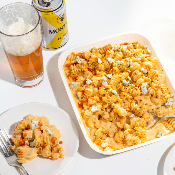 Platter and Plate of Murray's Buffalo Chicken Mac Served with Glass of Beer
