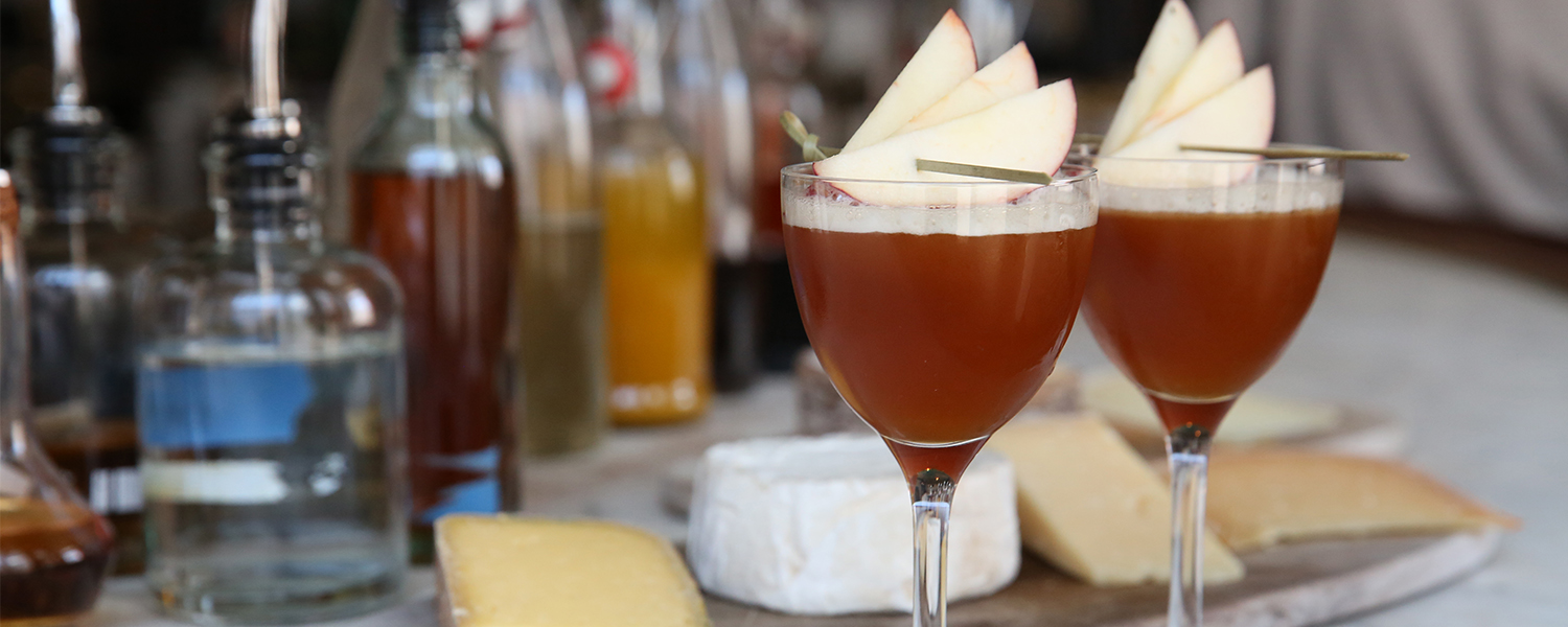 Between Two Apple Trees Cocktail in front of Cheese
