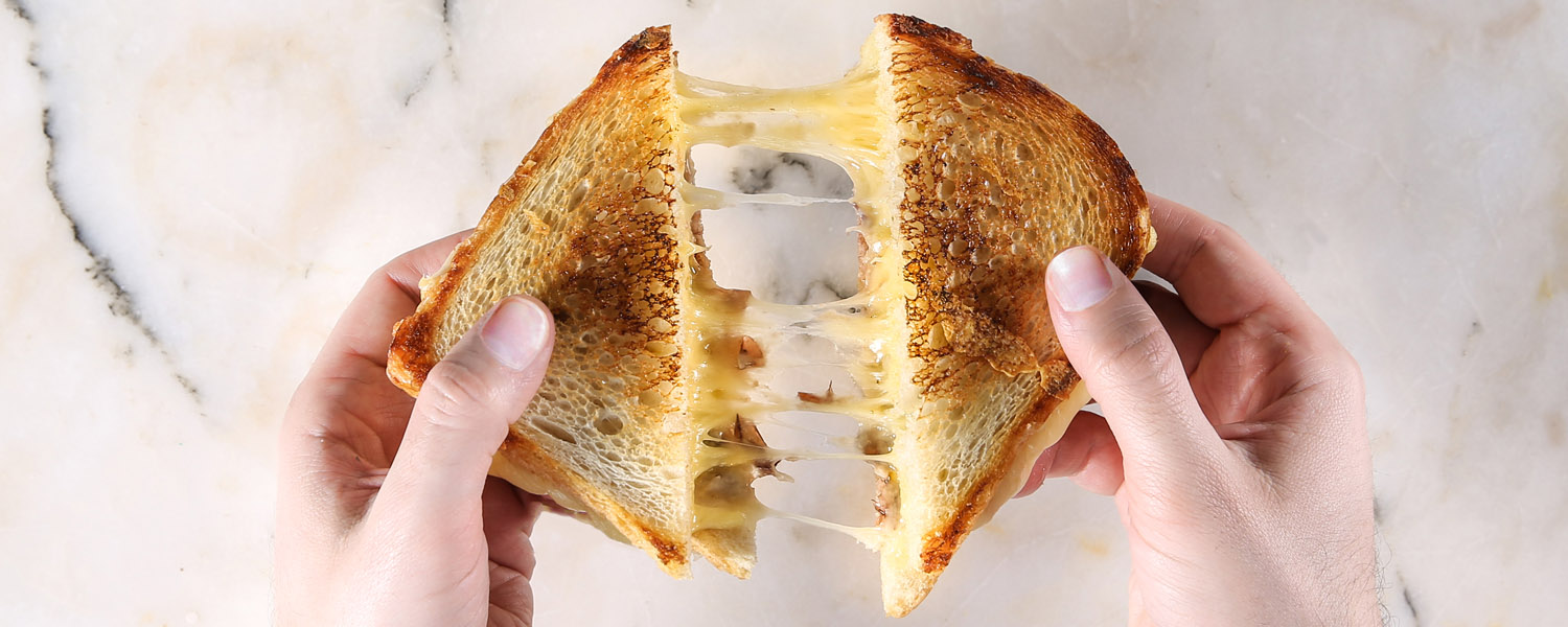 The Appleton Smoky Grilled Cheese gooey cheese pull