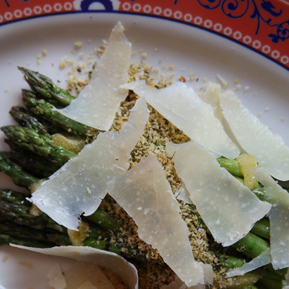 A close up of the Piave Vecchio cheese in the Grilled Asparagus with Meyer Lemon and Panko Crumble