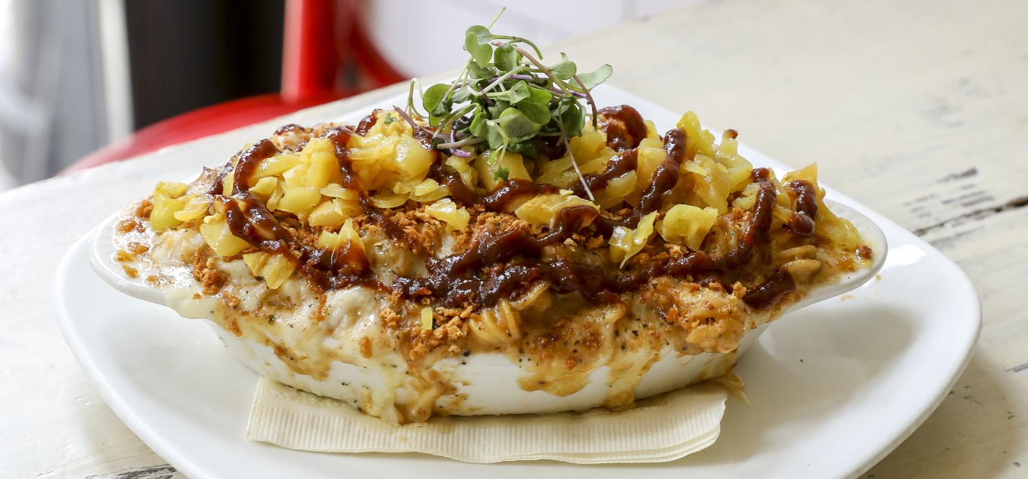 Award Winning Pulled Pork Mac and Cheese in a baking dish topped