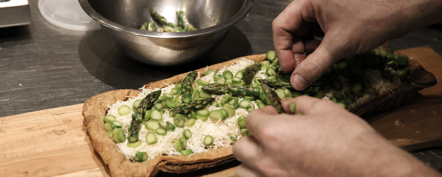 Zachary Golper Adding the Asparagus Topping to the Bien Cuit Asparagus, Fennel, and Reading Cheese Tart