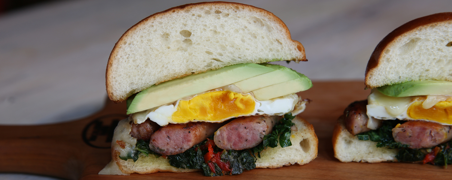 Cross section of the Sausage, Egg, Cheese and Kale Breakfast Sandwich