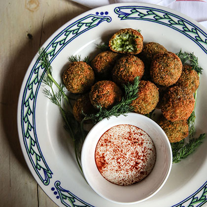 Dill Pickle Arancini on a plate with Cajun Remoulade