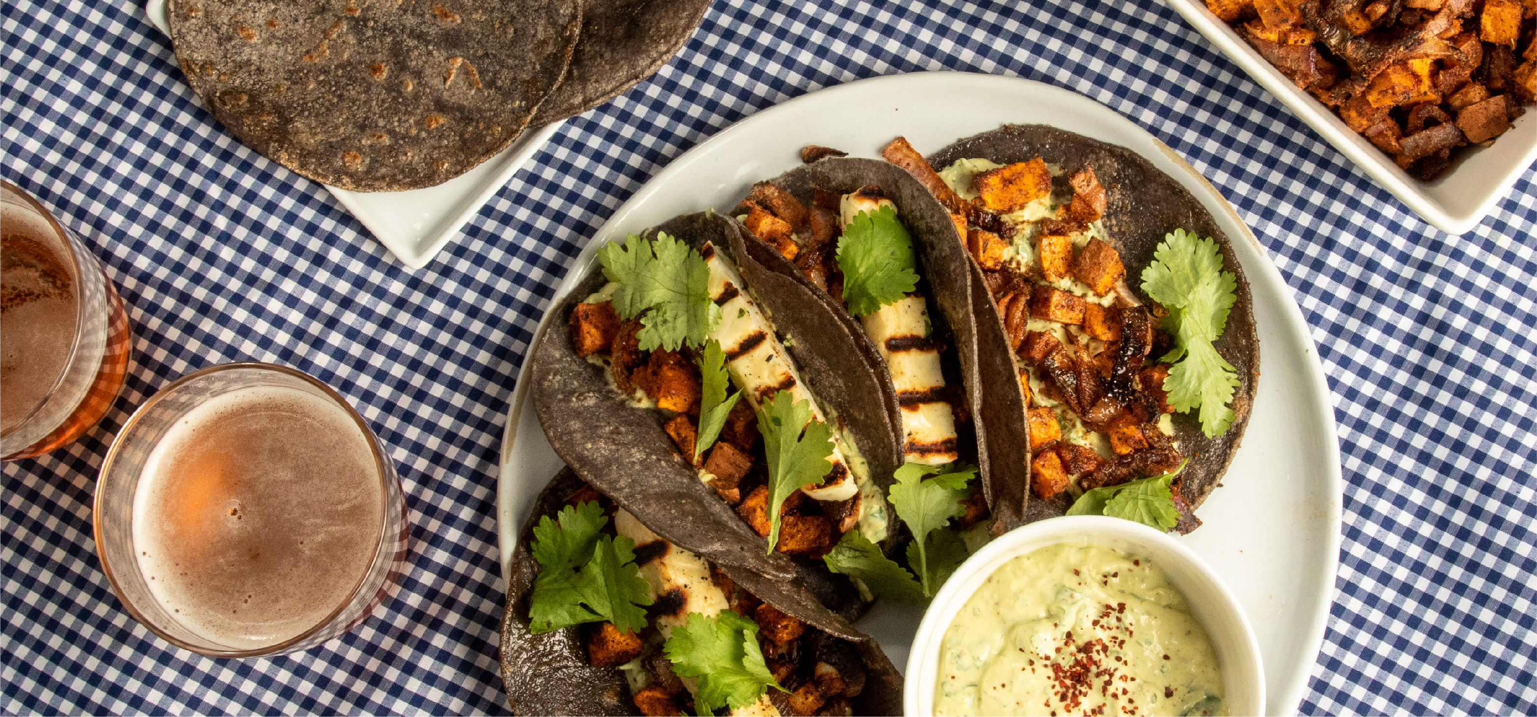 Grilled Halloumi Tacos with Sweet Potatoes and Avocado Crema