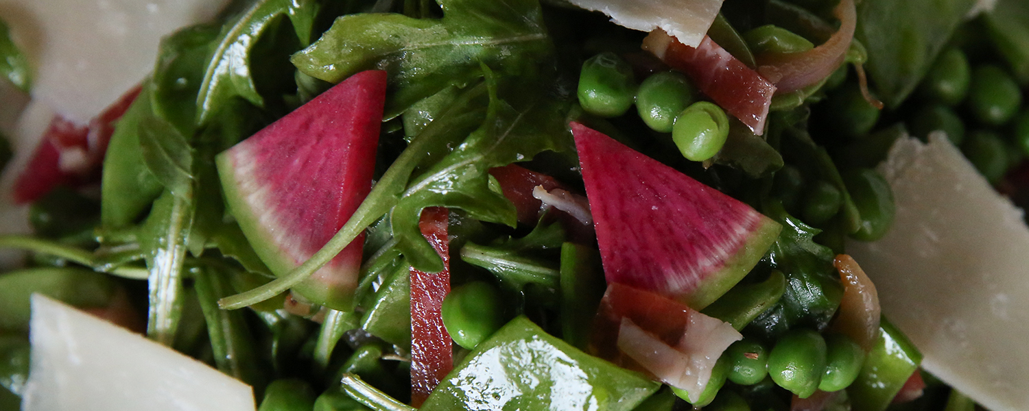 Primavera Spring Salad with Parmigian Reggiano and Prosciutto di Parma close up