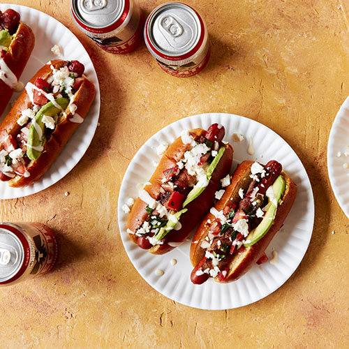 Overhead view of four Tijuana style hot dogs
